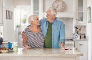 retired couple in kitchen