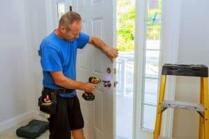 contractor replacing a front door lock