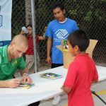 Tampa Bay Rowdies player Keith Savage signs autographs at the Bonita Springs soccer clinic.