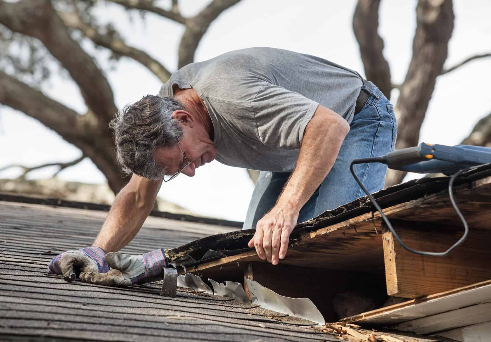 Man on damaged roof